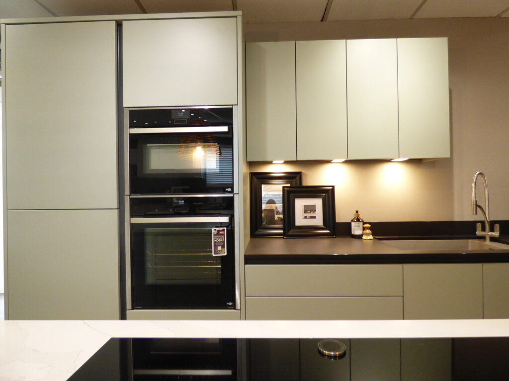 White Cabinets and Black Worktop and Ovens