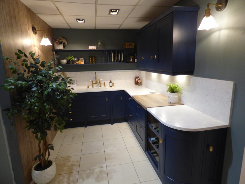 Small Kitchen with white worktops and blue cupboards